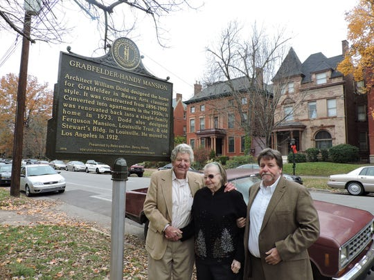 Ben and Reba Handy, left, and their son Greg Handy, pose with the new state highway historical marker in front of the Grabfelder-Handy Mansion on S. Third St. in Old Louisville.