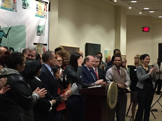 Mayor Mike Duggan, center, and other officials, announce