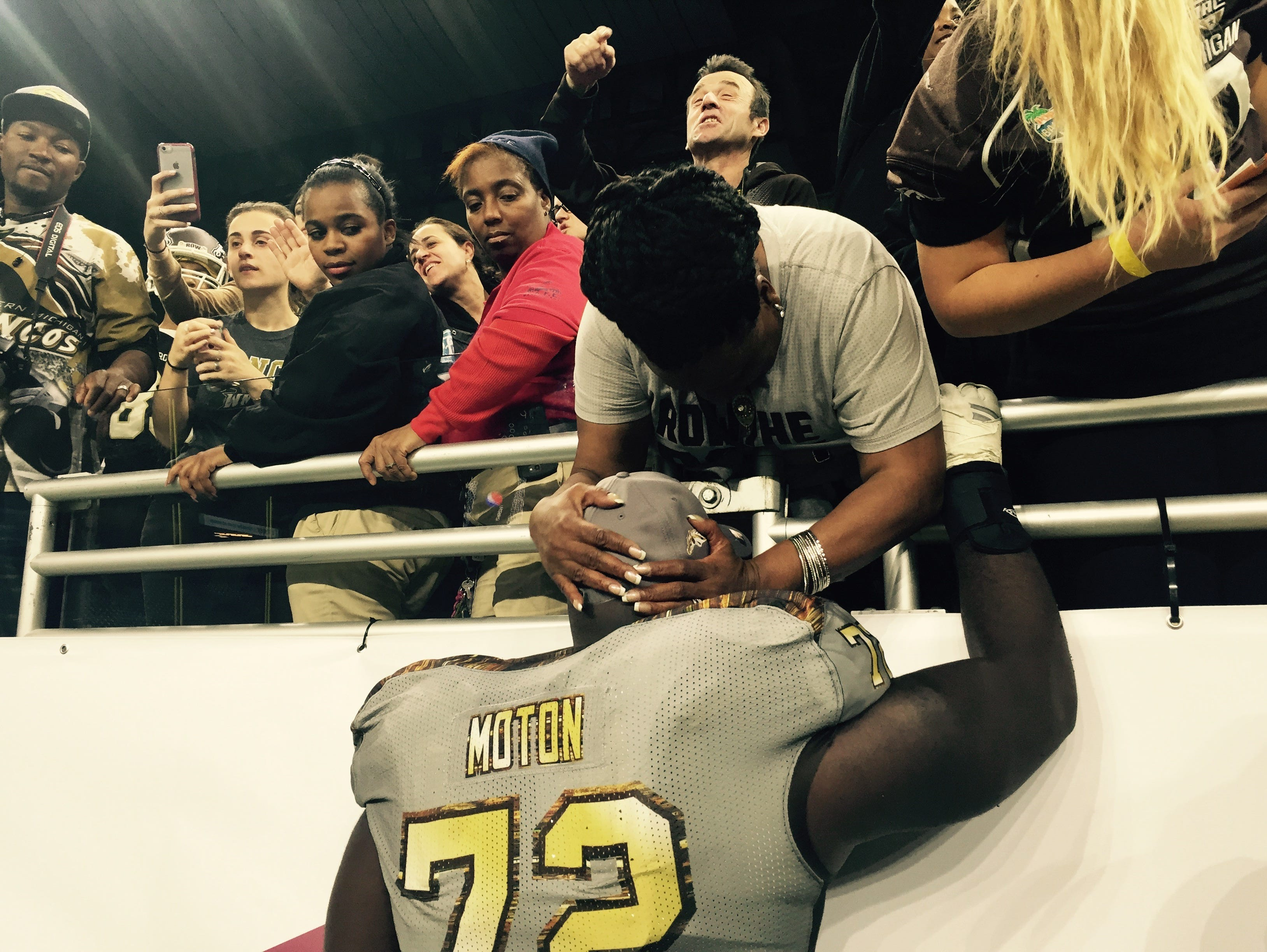 Senior Taylor Moton embraces his mother Sonya Gunnings-Husband after his Western Michigan Broncos knocked off Ohio 29-23 in the MAC Championship at Ford Field in Detroit on Dec. 2