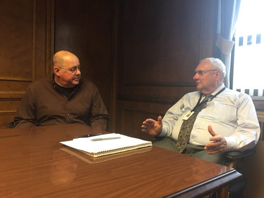 Ashland Mayor Glen Stewart talks to councilman Duane Fishpaw, who was appointed Wednesday to replace Stewart in January.