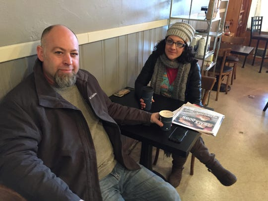 Silverton artist Joshua (J.W.) Kinsey, left, and his wife, Katie, stop by Silver Creek Coffee House to warm up. J.W. will be showing his artwork at Fernie Brae in Portland's Hawthorne District from Dec. 16 through Jan. 22.