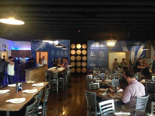 In this file photo, guests mingle during a soft opening at Big Blue Brewing in Cape Coral. General Manager Phil Brittain said the construction along SE 47th Terrace hasn't affected their business.