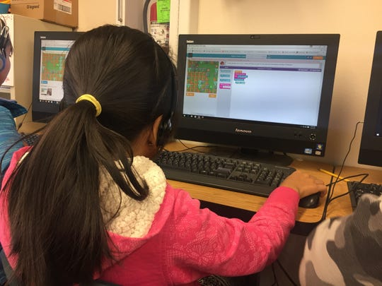 Fourth grade students at Sunset Elementary work on a 30-minute block during the Hour of Code for Computer Science Education Week.