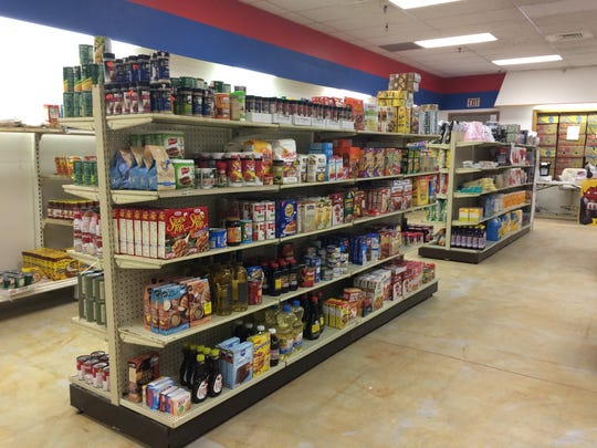 Grocery shelves are filled with discounted food at