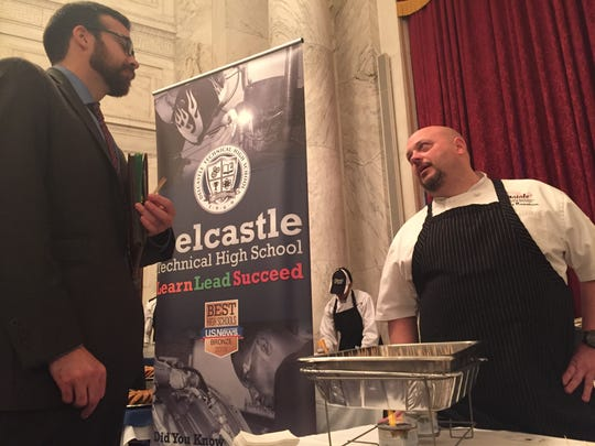 Billy Rawstrom, owner of Maiale Deli and Salumeria, talks to a guest at the Sixth Annual Taste of Delaware in Washington, D.C.