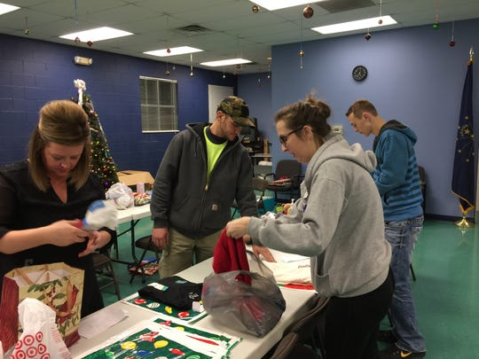 Volunteers gather to wrap presents for Gift Lift, a program that brings Christmas gifts to those in nursing homes and mental health care facilities.