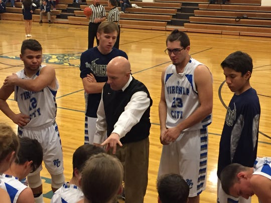 Virginia City boys basketball coach Tom Maurer instrucjs the Muckers during a time out Thursday.