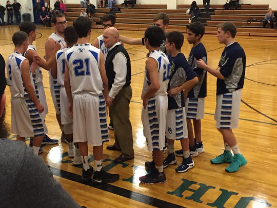 Tom Maurer instructs the Virginia City boys during a time out Thursday at the school.