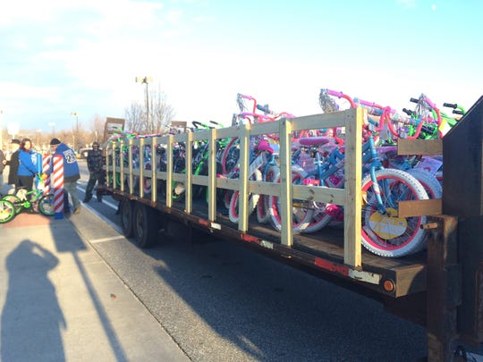Volunteers load the last of 100 bikes at Walmart in Deptford. The bikes, paid for with donations to the charity Pop's Dream, will be raffled off to kids at the Gloucester County Chamber of Commerce's Breakfast with Santa for kids involved with various social services agencies.
