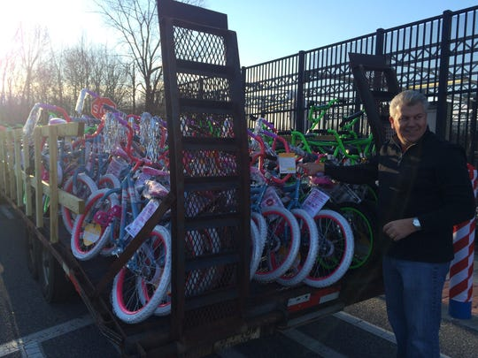 Jeff Sanders, founder of the charity Pop's Dream, stands with the 100 bikes he bought with donations. The bikes, purchased from Walmart in Deptford, will be raffled to kids attending the Gloucester County Chamber of Commerce's Breakfast with Santa this weekend.