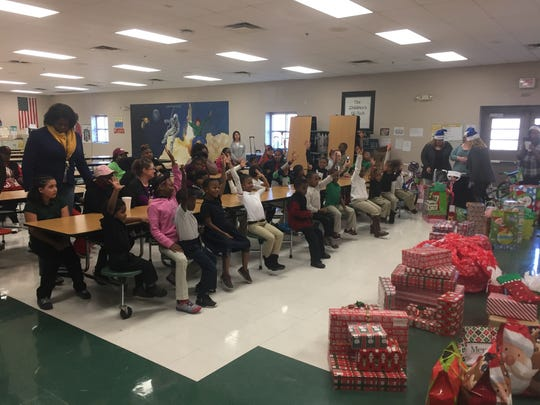 Express Employment Professionals sponsored Angel Tree Christmas gifts for Isaac Lane students Friday morning.