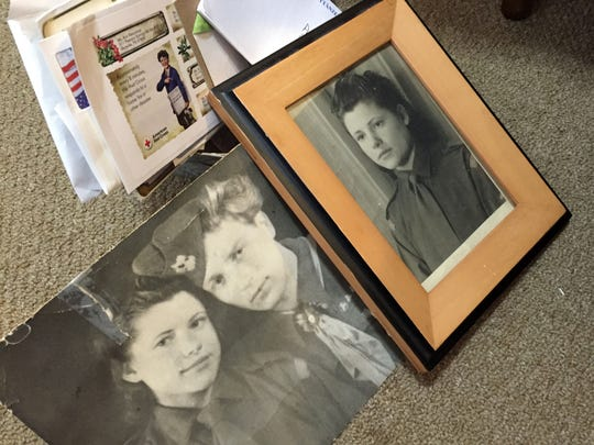 Photos of Ann Keraminas and her late husband sit at her feet in an assisted living center in Blount County.