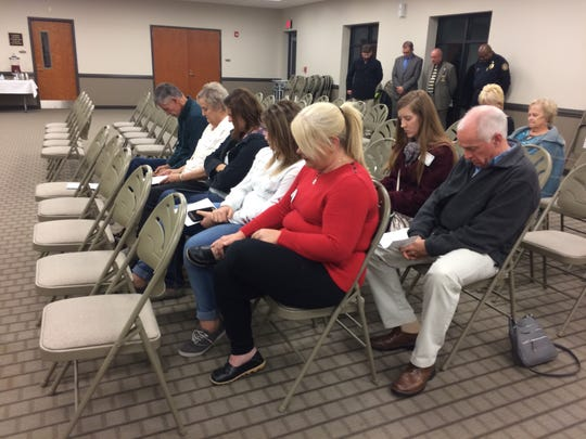 Loved ones of victims praying along with Rev. Quinton
