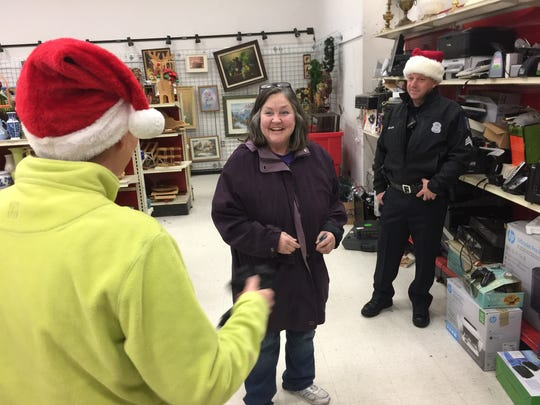 Deborah Brown of Southfield was surprised with a $100 bill from Secret Santas at the Salvation Army thrift store in Lincoln Park on Monday, Dec. 12, 2016. Brown said she would use the money to buy more gifts for her grandson.