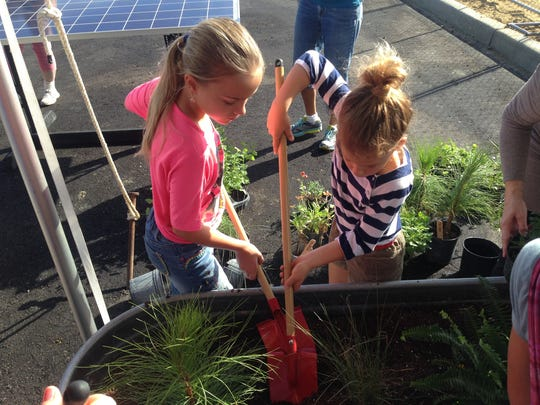 Children were asked to tend gardens as part of the groundbreaking ceremony for Babcock Neighborhood School, a charter school that will open next fall in the eco-city.