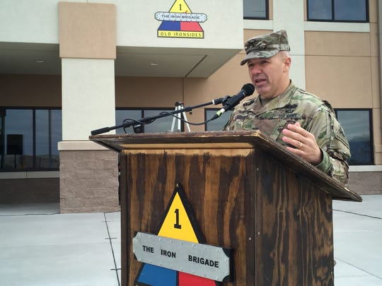 Col. Chuck Lombardo, commander of 2nd Armored Brigade Combat Team, talks during the brigade's recent change of mission ceremony.