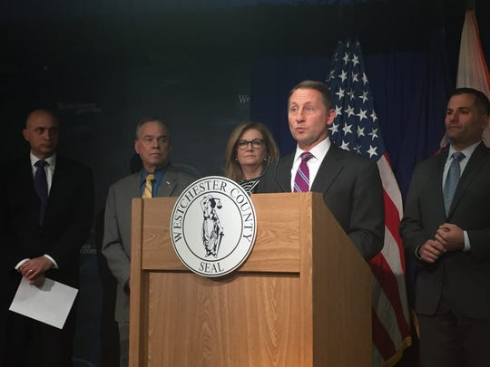 Westchester County Executive Rob Astorino, at podium,
