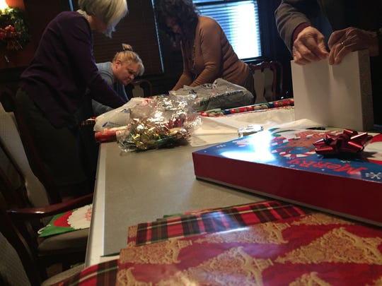 Binghamton Sertoma Club members wrapped presents for