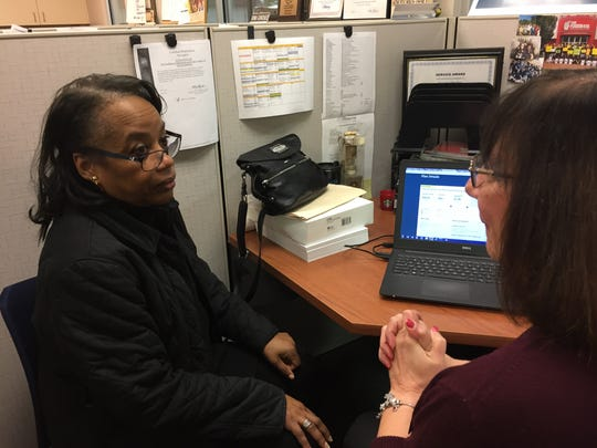 Wilhelmina Smith of Neptune discusses her health insurance options with Susan Fowler, a navigator with the Foodbank of Monmouth and Ocean Counties.