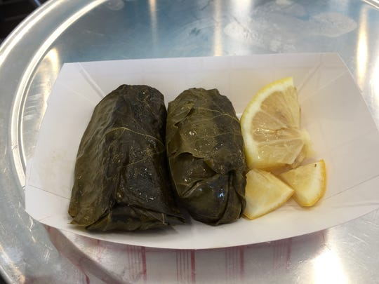 Stuffed grape leaves, or dolmades, are served with a side of lemon wedges at The Simple Greek.