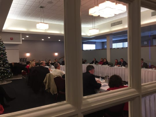 Gov.-elect Phil Scott meets with board members from the Vermont Association of Hospitals and Health Systems on Wednesday morning at the Capitol Plaza Hotel in Montpelier.