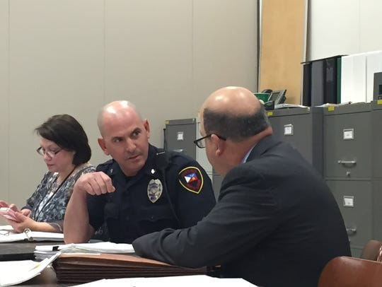 Martin Faul, a Lafayette police officer, confers with