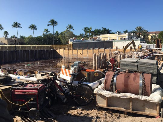 Construction crews can be seen from Fifth Avenue working in a 12-foot pit that covers Naples real-estate developer's half-acre lot at the 465 5th Ave. S.
