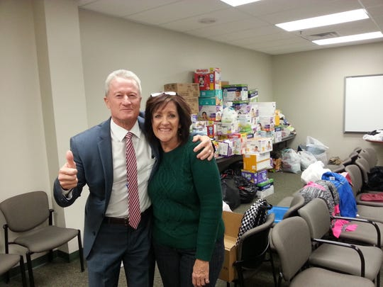 From left, Larry Bergeson, Washington County School District superintendent, and Pam Graf, WCSD Foundation director, stand in the district office's basement, surrounded by thousands of items donated for The Spectrum & Daily New's annual #StepUpSTG fundraiser for homeless students.