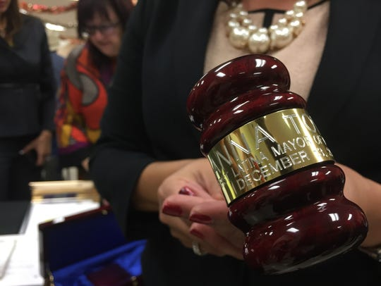 "Tolleson Mayor Anna Tovar holds a gavel that says ""Anna"
