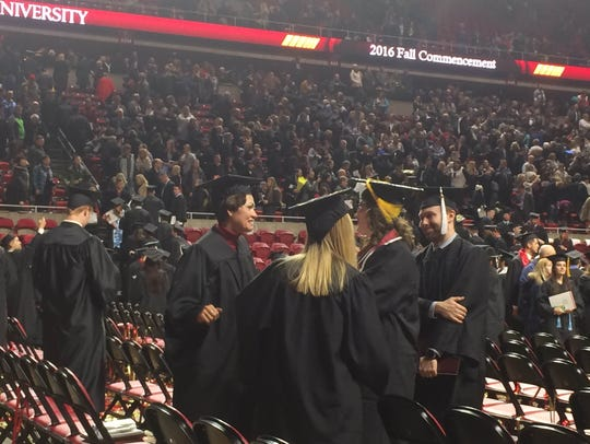 Reynolds takes photos with ISU grads after the ceremony.