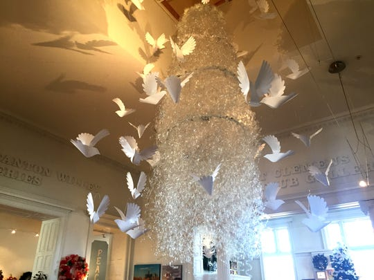 A chandelier made of water bottles collected by Flint