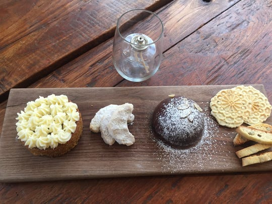 Desserts created by Angela Ranalli-Cicala at Le Virtú include (from left) an olive oil carrot cake; Mezzaluna cookies; Parrozzo, an almond cake; pizzelles and biscotti.