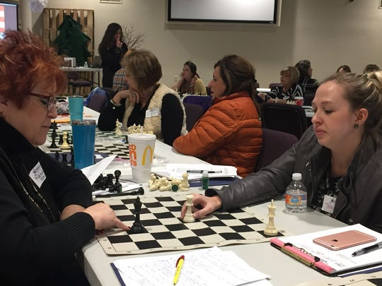 Randi Sauder (left) and Traci Gregg, both teachers at Oak Grove Central Elementary, practicing their chess skills.