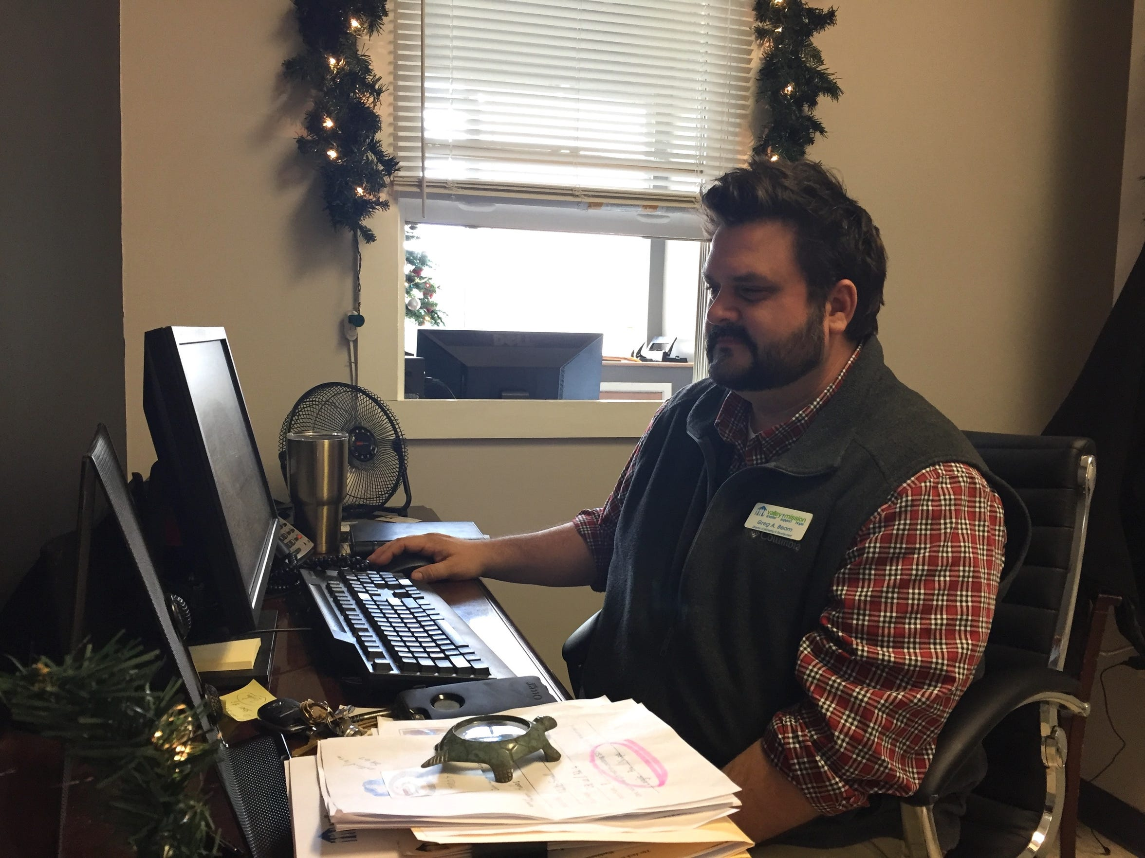 Greg Beam, director of marketing and development, in his office at the Valley Mission in Staunton on Monday, Dec. 12, 2016.