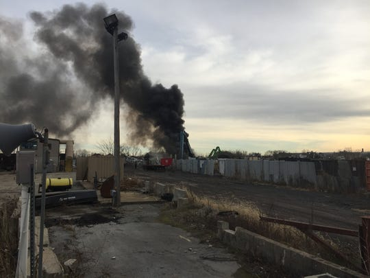 Firefighters are at the scene of a blaze at a recycling