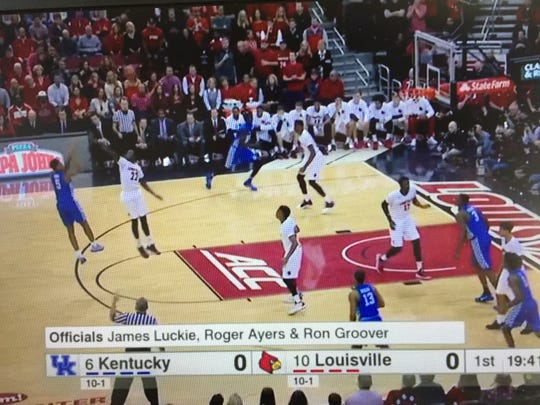 Louisville's Deng Adel contests Kentucky wing Malik Monk's first shot attempt of the game.