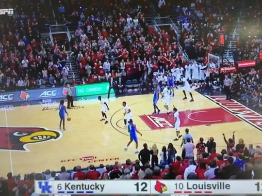 Louisville's altered 2-3 matchup zone had point guard Quentin Snider playing on a wing and Deng Adel and Donovan Mitchell up front to combat Kentucky's length in the backcourt.