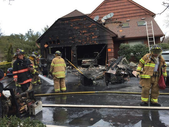 Firefighters battled a house fire on Five Points Road in Howell on Dec. 22.