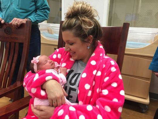 Kristin Balkovec rocks daughter Lyla, who was born