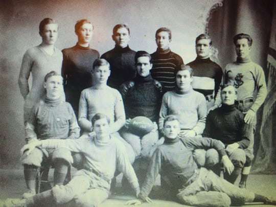 Louis Mohs poses with his intramural football team
