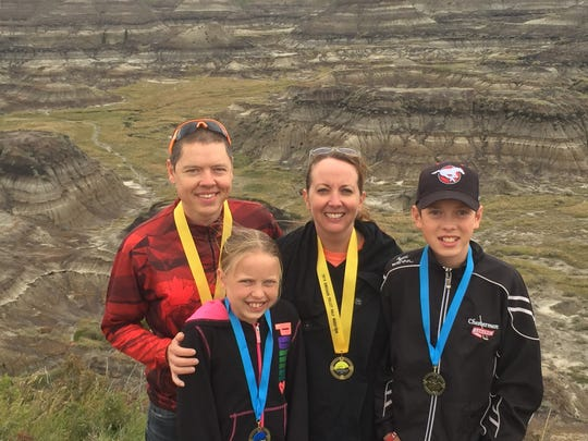 Craig (left) and Bobbi Skrynyk (second from left) ran the Drumheller half-marathon in the quest to run 50 13.1-mile races before they're 50. They will run their 69th half marathon at the American Bank Center Half Marathon on Saturday. They brought their children, Paytin (second from left) and Noah, along to the Drumheller half-marathon, and they will tag along to Corpus Christi with their parents.