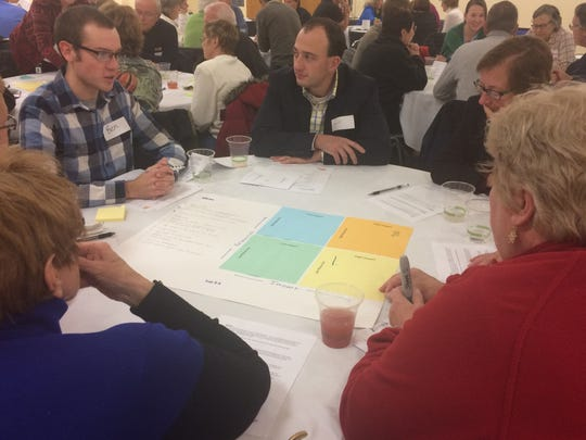 Ben Larson leads a group in discussions about fundraising