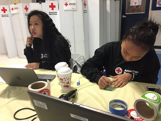 Premika Mager and Neesha Monger check donors into the