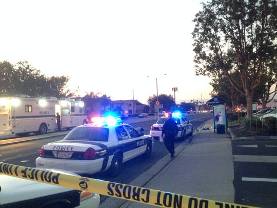 Oxnard police work at the scene of a June homicide in the 1900 block of North Ventura Road.