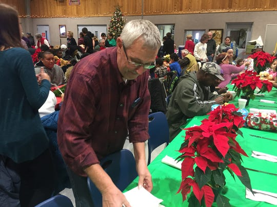 Volunteer Ron Newcomer helps set up an extra table at the Salvation Army's Christmas Dinner on Christmas Day 2016. Dinner organizer Lynne Newcomer estimated 700 people would come through.