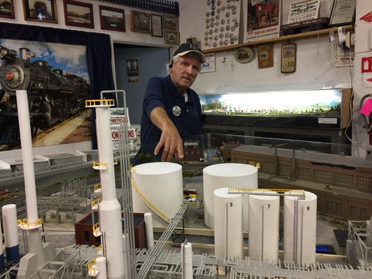 Cumberland Valley Model Railroad Club vice president Bill Robinson shows off the club's newest addition to its massive model train collection -- an oil refinery and scrap yard -- during the club's 20th annual Model Train Show.