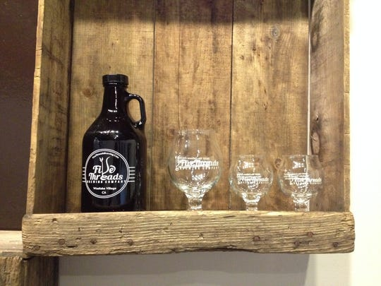 A growler and glasses are displayed at Five Threads Brewing Co. in Westlake Village. The brewery is participating in FOOD Share of Ventura County's Growlers for Meals program through Dec. 31.