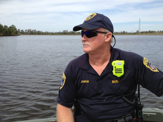 Deputy Ron Johnson of the Calcasieu Parish, La., Sheriff's Office steers Will Horton to the area where his sister, Mary Horton Vail, drowned a half century earlier.