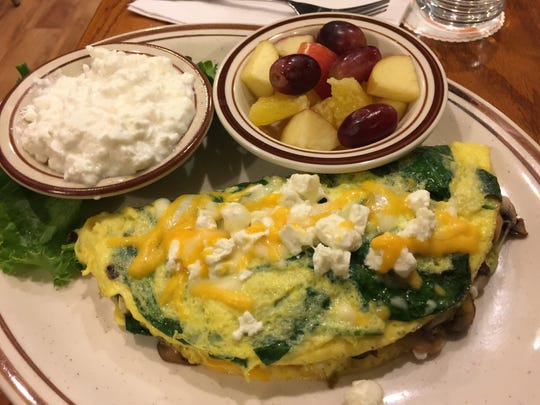 Florentine omelet with fresh fruit, cottage cheese.
