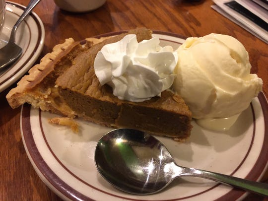 Pumpkin pie with ice cream.